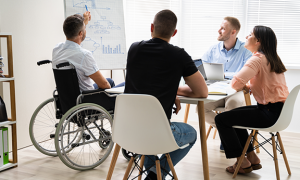 Wheelchair And Disability At Office. Giving Presentation At Work